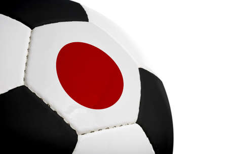 Japanese flag painted/projected onto a football (soccer ball).  Isolated on a white background. Stock fotó