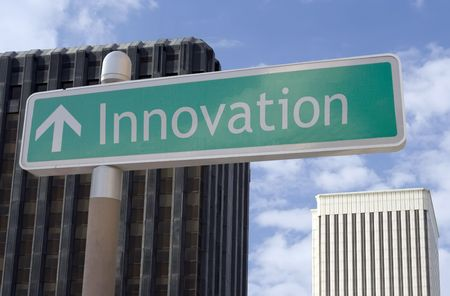 "Street sign with an arrow and the words ""innovation"" located in a business district"