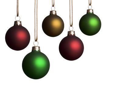 adorn: Five christmas ornaments in various sizes hanging isolated on a white background - with copyspace. Stock Photo