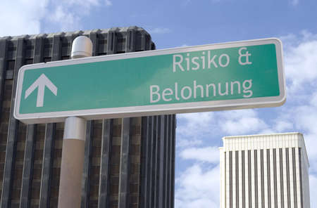 risiko: Street sign with an arrow and the German words
