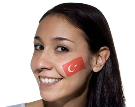 Smiling woman with a Turkish flag painted on her cheek.