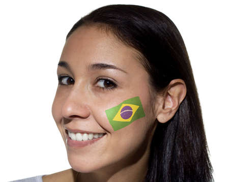 Smiling woman with a Brazilian flag painted on her cheek. photo