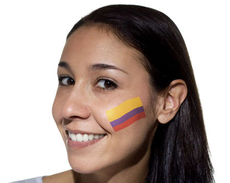 colombian flag: Smiling woman with a Colombian flag painted on her cheek. Stock Photo