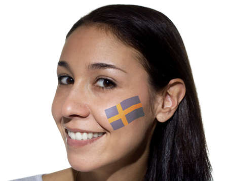 sweden flag: Smiling woman with a Swedish flag painted on her cheek.