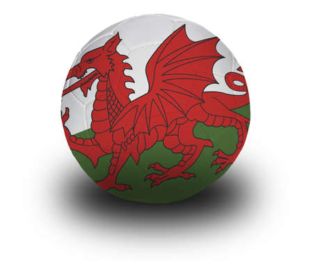 welsh flag: Football (soccer ball) covered with the Welsh flag with shadow on a white background.