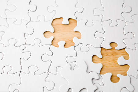 Blank jigsaw puzzle on a table with missing pieces Reklamní fotografie
