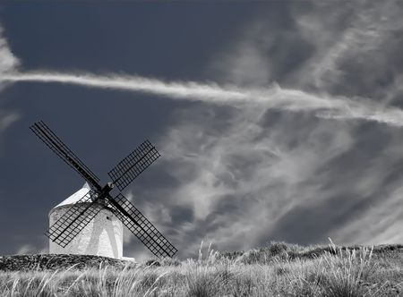 Medieval windmill dating from the 16th century on a hill overlooking the town of Consuegra in Toledo province, Castilla La Mancha, central Spain.  Stock Photo