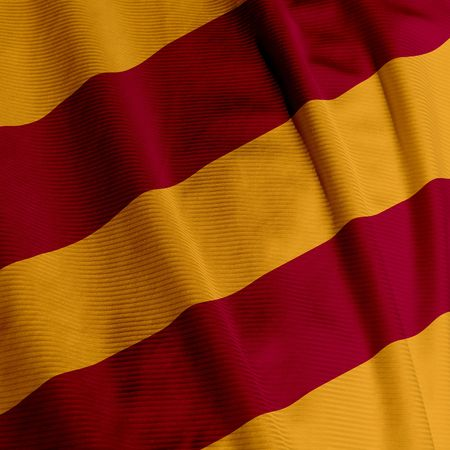 Close up of a red and yellow colored flag Stock Photo