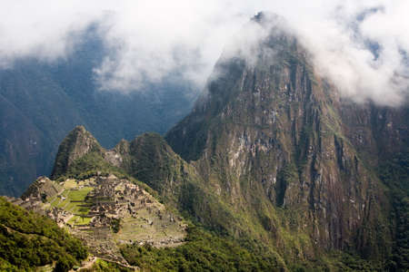 Panorama view of the ancient Incan city of Machu Picchu, designated an UNESCO World Heritage Site photo