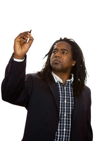 Smiling African adult male businessman with dreadlocks dressed in business casual writing with a marker. Stock Photo