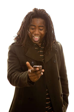 African adult male with dreadlocks receiving good news on his mobile phone. photo