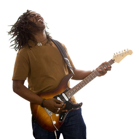 African adult male with dreadlocks flying jamming on a guitar on a white background.