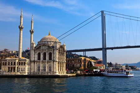 View of the Büyük Mecidiye Mosque and the Bosphorus Bridge in Istanbul, turkey. Imagens