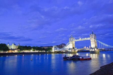 View of the Tower Bridge and Tower of London at dusk. photo