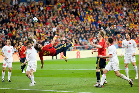 MADRID - MAR. 28, 2009: Spain's Sergio Ramos bicycle kick shot goes just wide during the second half of their 1-0 victory over Turkey in their World Cup Qualifier.