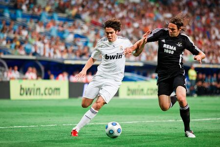 MADRID - AUG. 24, 2009: Kaka attempts to dribble around a defender during Real Madrids 4-0 victory over Rosenborg BK in the Trofeo Santiago Bernabeu.