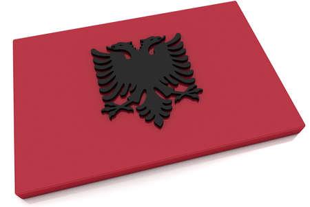 albanian: Three dimensional Albanian flag button.  Stock Photo