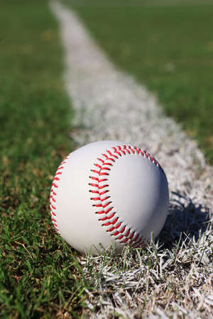 outfield: Close-up of a baseball on the outfield foul line.