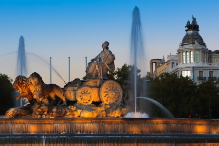 The fountain at the Plaza de Cibeles in Madrid, Spain at dusk.  The fountain is a famous landmark of Madrid.