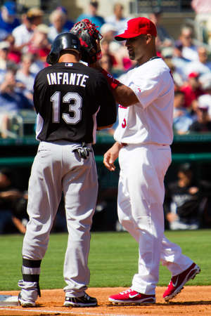 JUPITER, FL USA - Feb. 28, 2011: St. Louis Cardinals player Albert Pujols gives Marlins player Omar Infante a pat on the helmet during the St. Louis Cardinals vs. Florida Marlins pre-season game. Stock Photo - 8945147