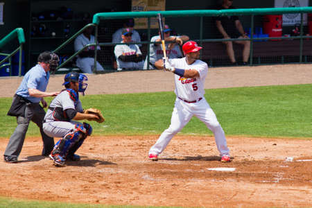 JUPITER, FL USA - MAR. 27: Cardinal first baseman Albert Pujols bats during the New York Mets vs. St. Louis Cardinals spring training game March 27, 2010 in Jupiter, FL.
