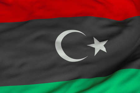 libyan: Detailed 3D rendering closeup of the flag of the Libyan Republic. Flag has a detailed realistic fabric texture and an accurate design and colors. Stock Photo