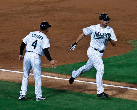 home run: MIAMI, FL USA - APR. 22: Marlin first baseman Gaby Sanchez rounds the bases after hitting a solo home run in the third inning of the Colorado Rockies vs. Florida Marlins game April 22, 2011 in Miami, FL.