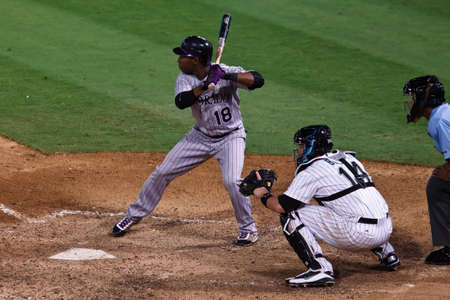 baseman: MIAMI, FL USA - APR. 22: Rockies second baseman Jonathan Herrera bats during the ninth inning of the Colorado Rockies vs. Florida Marlins game April 22, 2011 in Miami, FL. Editorial