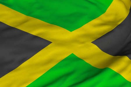 Detailed 3D rendering closeup of the flag of Jamaica.  Flag has a detailed realistic fabric texture and an accurate design and colors. Stock Photo - 9400513