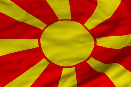 Detailed 3D rendering closeup of the flag of Macedonia.  Flag has a detailed realistic fabric texture and an accurate design and colors. Stok Fotoğraf