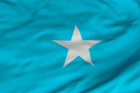 somalian: Detailed 3D rendering closeup of the flag of Somalia.  Flag has a detailed realistic fabric texture and an accurate design and colors.