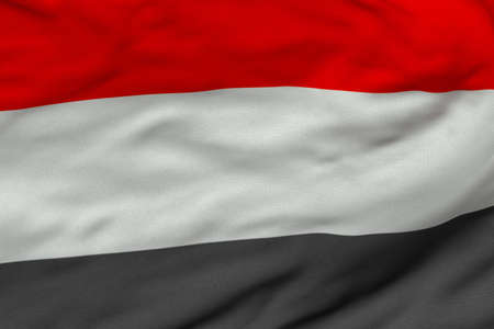 Detailed 3D rendering closeup of the flag of Yemen.  Flag has a detailed realistic fabric texture and an accurate design and colors.