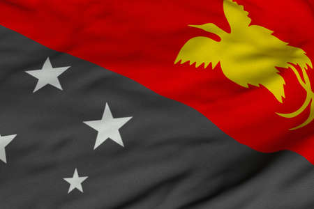 Detailed 3D rendering closeup of the flag of Papua New Guinea.  Flag has a detailed realistic fabric texture and an accurate design and colors.