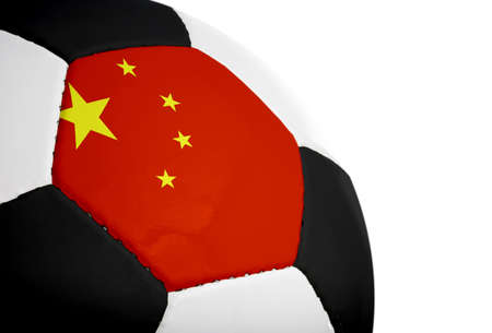 Chinese flag paintedprojected onto a football (soccer ball).  Isolated on a white background.