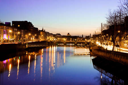 Dublin City at sunset - view over the river Liffey and historical Grattan bridge. Long exposure, tripod used.