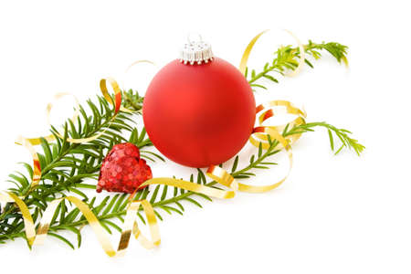 Celebrating Christmas love with festive border, traditional pine tree branch, red bauble decoration and sparkling heart. Isolated on white background. photo