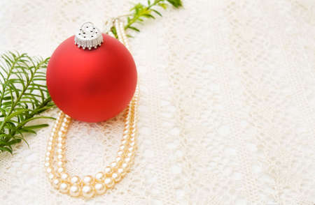 Vintage Christmas with red bauble and pearls photo