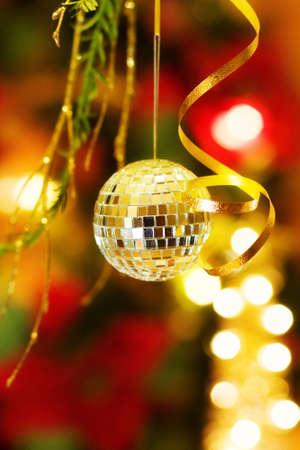 Christmas disco ball over golden tree photo