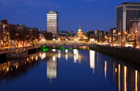 Dublin city at sunset with view over OConnell Bridge and Liffey river.