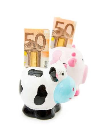 cash cow: Piggy and Cowie money banks