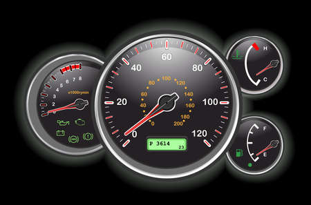 controls: Car speedometer and dashboard at night.