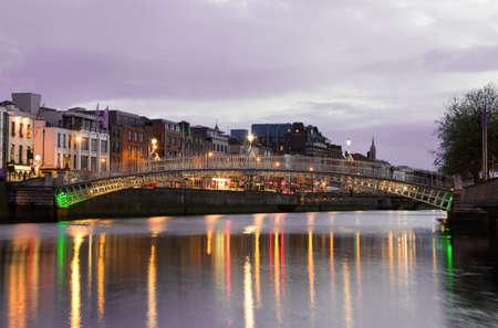 liffey: The Hapenny (Hapenny) Bridge - Dublin famous landmark. At sunset.