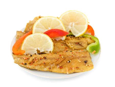 Tasty peppered mackerel fillet with lemons. Isolated over\ white background.