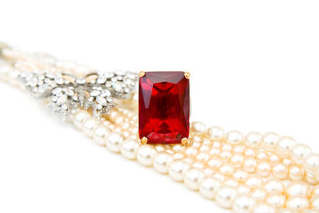 bijoux: Beautiful jewellery - red ruby ring, diamonds butterfly and string of pearls. Isolated over white background. Stock Photo