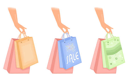 Woman holding shopping bags - set of three icons. Isolated over white background.   Stock Vector - 9712959
