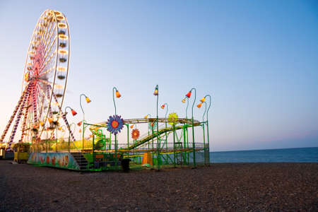 Vacation fun - amusement park on the beach near the ocean with ferris wheel and roller coaster. Shot taken in Bray, county Wicklow, Ireland