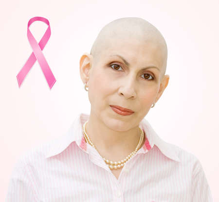 Breast cancer ribbon - portrait of patient undergoing chemotherapy. Real woman, diagnosed with breast and ovarian cancer.
