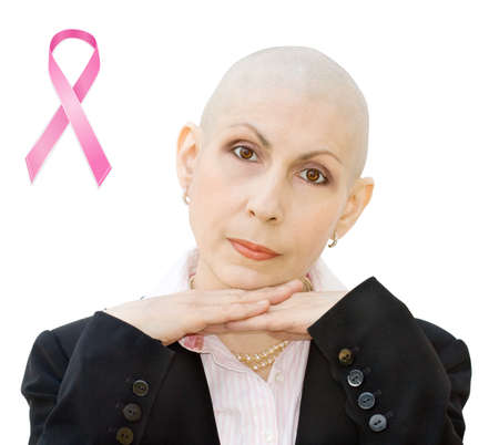 Breast cancer survivor undergoing chemotherapy and loss of hair. Real woman, diagnosed with breast cancer and ovarian cancer. Isolated over white background. photo