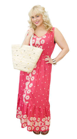 maxi dress: Summer holidays fun - beautiful blonde woman with beach bag and maxi dress, smiling and getting ready to go to the beach or shopping. Isolated over white background.