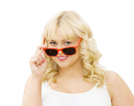 makeups: Summer fun - beautiful woman wearing red sunglasses and smiling. Isolated over white background.